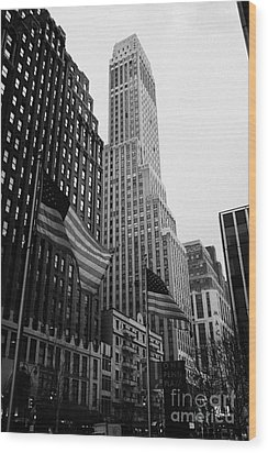 view of pennsylvania bldg nelson tower and US flags flying on 34th street from 1 penn plaza new york Wood Print by Joe Fox