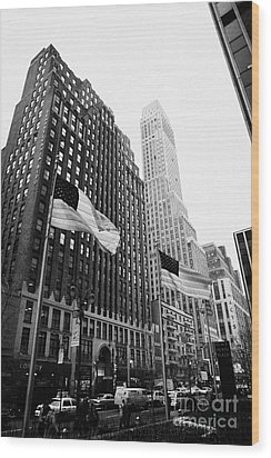 view of pennsylvania bldg nelson tower and US flags flying on 34th street new york city Wood Print by Joe Fox
