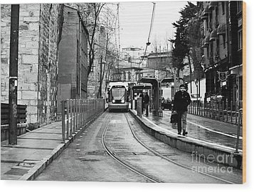 Waiting For The Tram In Istanbul Wood Print by John Rizzuto