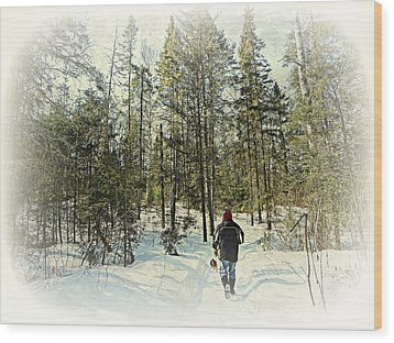 Walking The Dog On A Snowy Trail Wood Print by Dianne  Lacourciere