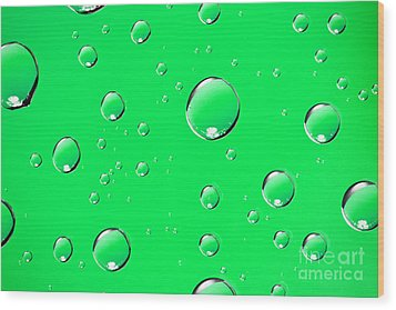 Water Drops On Green Wood Print by Sharon Dominick
