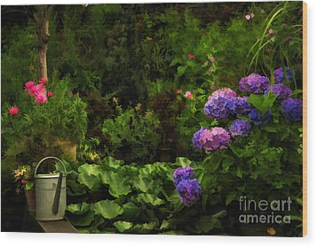Watering Can In A Beautiful Garden Wood Print