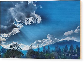 Westerly Clouds Wood Print by Julia Hassett