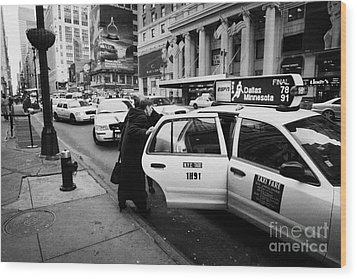 white middle aged passengers exit from yellow cab rear door at taxi rank on 7th Avenue Wood Print by Joe Fox