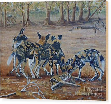 Wild Dogs After The Chase Wood Print by Caroline Street