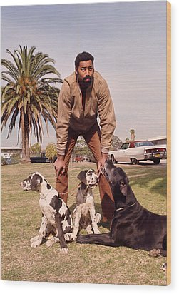 Wilt Chamberlain With Dogs Wood Print by Retro Images Archive
