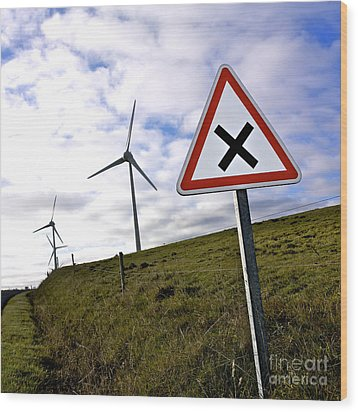 Wind Turbines On The Edge Of A Field With A Road Sign In Foreground. Wood Print by Bernard Jaubert