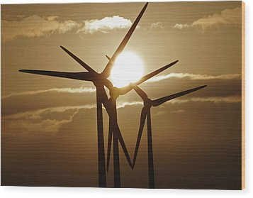 Wind Turbines Silhouette Against A Sunset Wood Print
