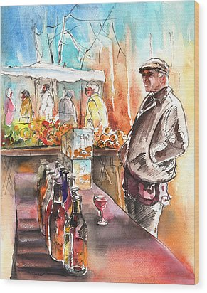 Wine Vendor In A Provence Market Wood Print by Miki De Goodaboom
