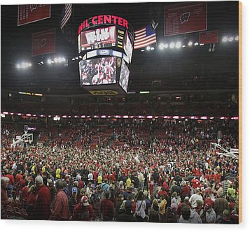 Wisconsin Fans Rush The Court At The Kohl Center Wood Print by Replay Photos