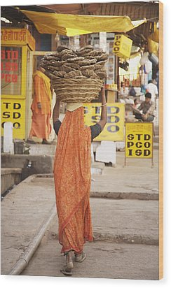 Woman Carrying Cow Dung In Basket On Wood Print by Paul Miles