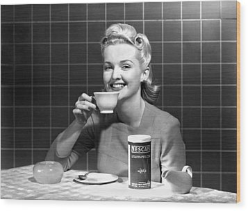 Woman Drinking Nescafe Wood Print by Underwood Archives