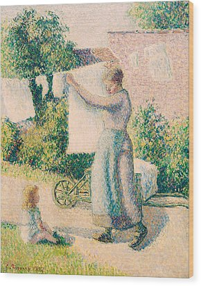 Woman Hanging Laundry Wood Print by Camille Pissarro