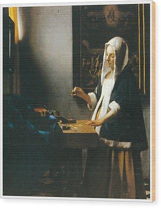 Woman Holding A Balance Wood Print by Johannes Vemeer