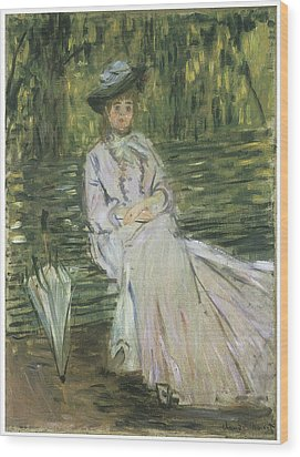 Woman Seated On A Bench Wood Print by Claude Monet