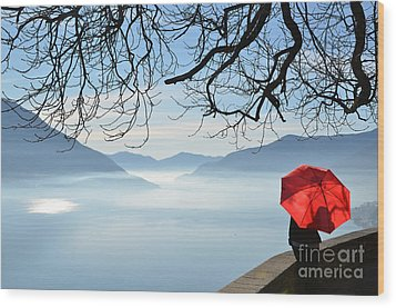 Woman Standing With A Red Umbrella Wood Print by Mats Silvan