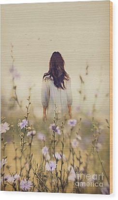 Woman Walking In Field Of Blue Flowers Wood Print by Sandra Cunningham