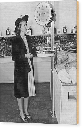 Woman Weighing Vegetables Wood Print by Underwood Archives
