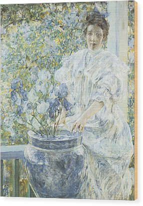 Woman With A Vase Of Irises Wood Print by Robert Reid