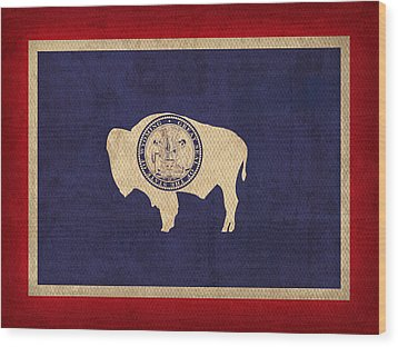 Wyoming State Flag Art On Worn Canvas Wood Print by Design Turnpike