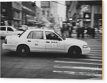 Yellow Cab Blurring Past Crosswalk And Pedestrians New York City Usa Wood Print by Joe Fox
