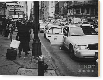 Yellow Cab On Taxi Rank Outside Madison Square Garden On 7th Avenue New York City Usa Wood Print by Joe Fox
