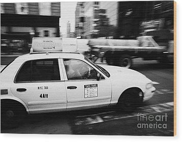 Yellow Cab With Advertising Hoarding Blurring Past Crosswalk And Pedestrians New York City Usa Wood Print by Joe Fox