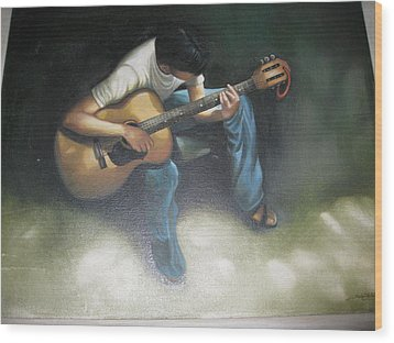 Young Boy Playing The Guitar Wood Print