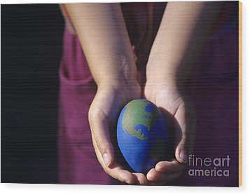 Young Girl Holding Earth Egg Wood Print by Jim Corwin