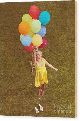 Young Happy Woman Flying On Colorful Helium Balloons Wood Print by Oleksiy Maksymenko