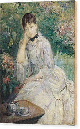 Young Woman Seated On A Sofa Wood Print by Berthe Morisot