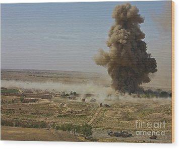 A Cloud Of Dust And Debris Rises Wood Print by Stocktrek Images