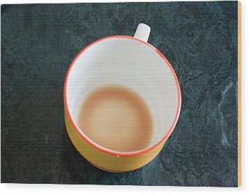 A Cup With The Remains Of Tea On A Green Table Wood Print by Ashish Agarwal