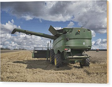 A Large Combine Harvester Machinery Wood Print by Jaak Nilson