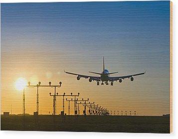 Aeroplane Landing At Sunset, Canada Wood Print by David Nunuk