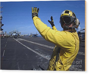 An Aviation Boatswains Mate Directs Wood Print by Stocktrek Images