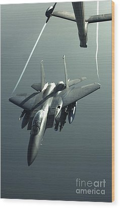 An F-15e Strike Eagle Flies Over Iraq Wood Print by Stocktrek Images