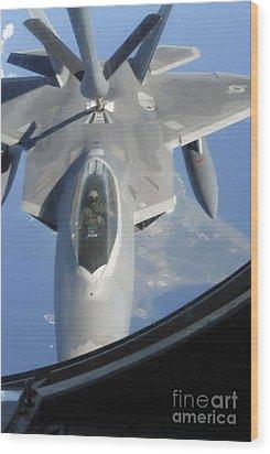 An F-22 Raptor Receives Fuel Wood Print by Stocktrek Images