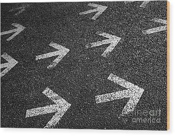 Arrows On Asphalt Wood Print by Carlos Caetano