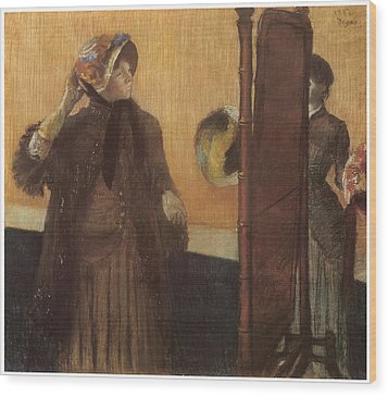 At The Milliner's Wood Print by Edgar Degas