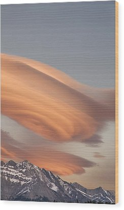 Clouds At Sunset Above Mountain Peaks Wood Print by Eryk Jaegermann