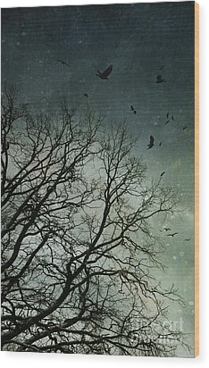 Flock Of Birds Flying Over Bare Wintery Trees Wood Print by Sandra Cunningham