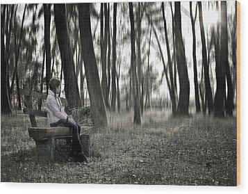 Girl Sitting On A Wooden Bench In The Forest Against The Light Wood Print by Joana Kruse
