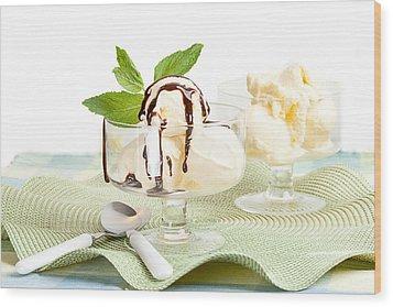 Glass Bowl With Vanilla Ice Cream And Chocolate Sauce Wood Print by Lorraine Kourafas