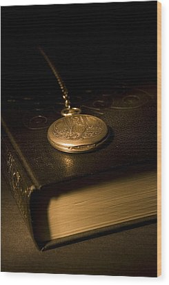 Gold Pocket Watch Resting On A Book Wood Print by Philippe Widling