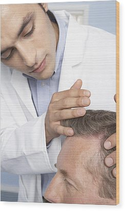 Hair Transplant Consultation Wood Print by Adam Gault