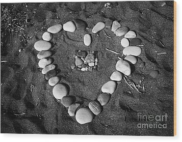 Heart Symbol Made Out Of Pebbles On The Beach At Aphrodites Rock Petra Tou Romiou Cyprus Wood Print by Joe Fox