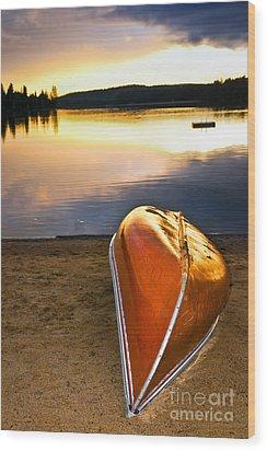 Lake Sunset With Canoe On Beach Wood Print by Elena Elisseeva