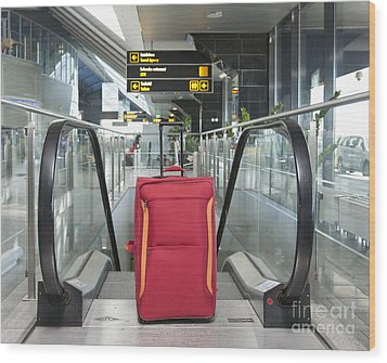 Luggage At The Top Of An Escalator Wood Print by Jaak Nilson