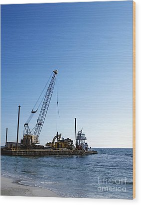 Machinery Cleaning Up A Pier Wood Print by Skip Nall